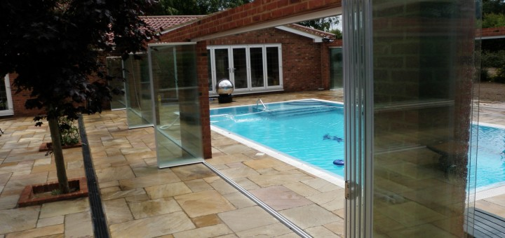Frameless Glass Door Enclosures around outdoor swimming pool