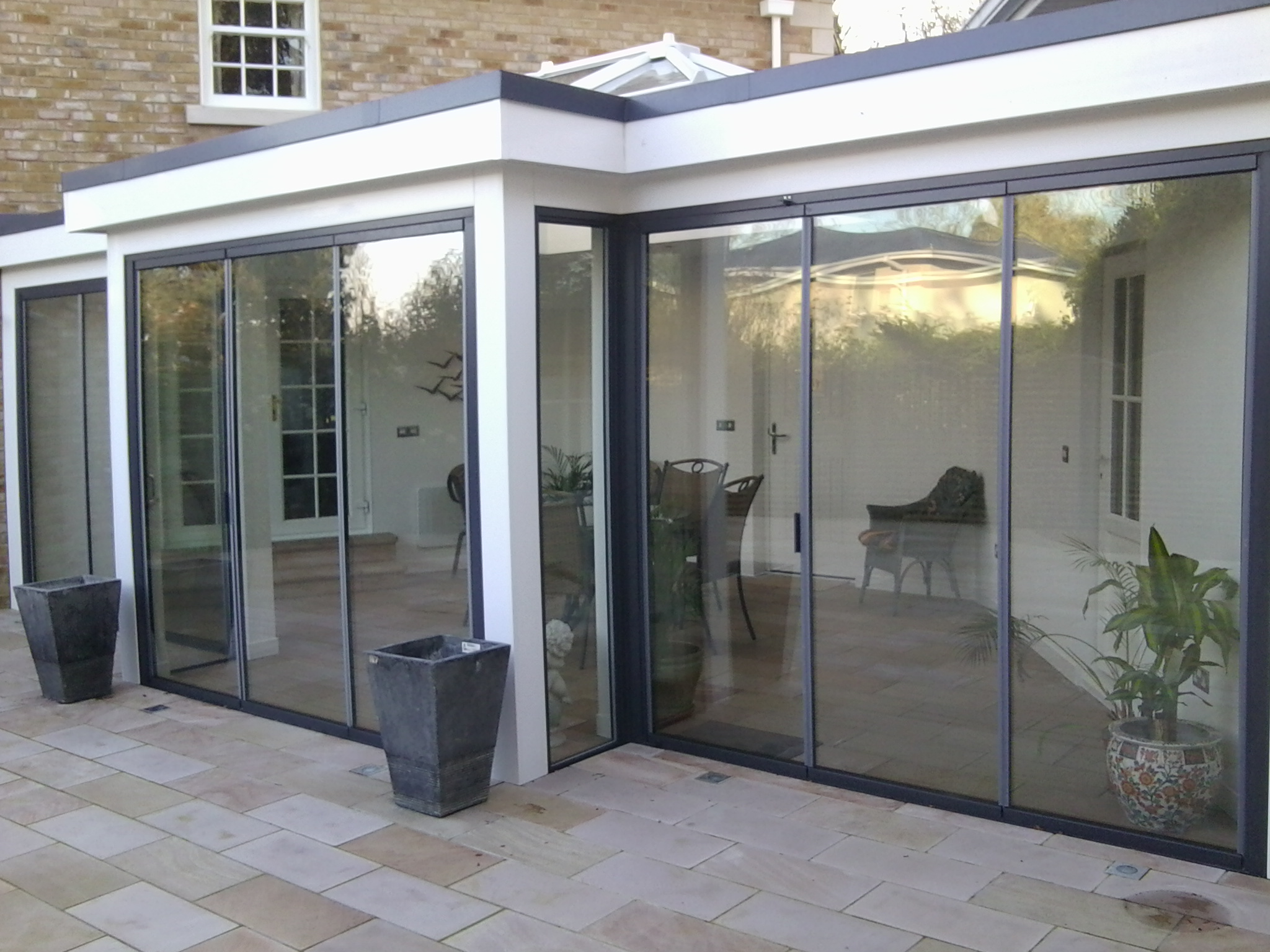 Ultraslim slide and turn pivot swing glass doors from for Backyard sliding door