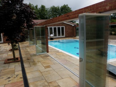 Retractable Frameless Glass Doors as Pool Enclosure - open