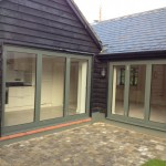 Bi Folding Doors for a Barn-style home and Courtyard setting