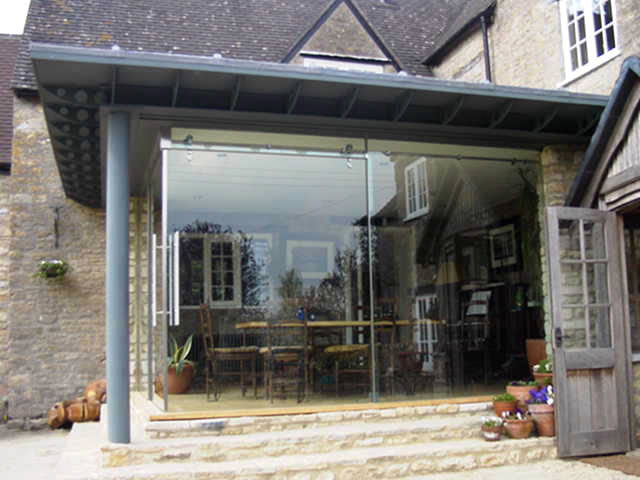 Frameless bi fold doors gallery all styles for Corner sliding glass doors
