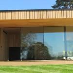 Sightline Doors, very wide glass sliding doors, partly open