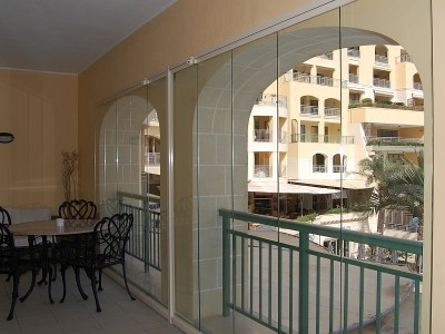 balcony with glass curtains